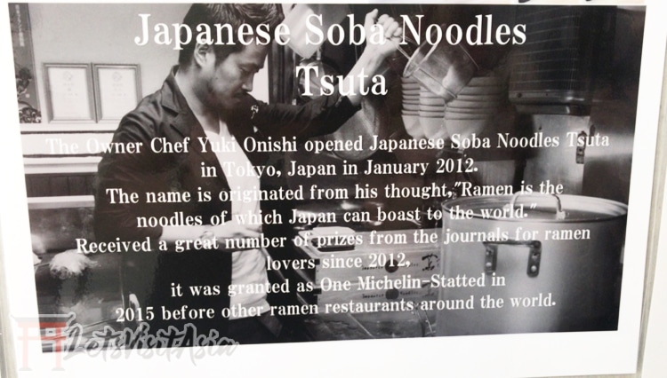 A small sign inside Tsuta Ramen in Tokyo explaining the backstory of the retaurant.