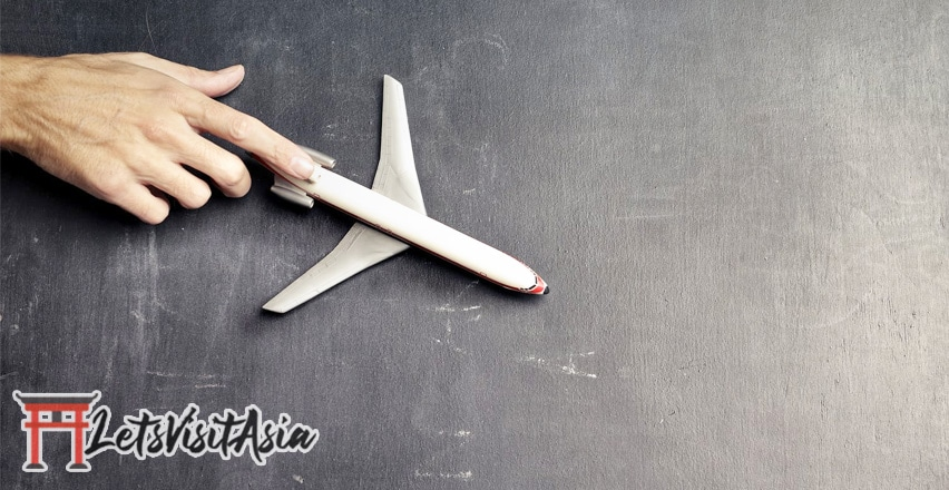 An image of a toy plane traveling to asia
