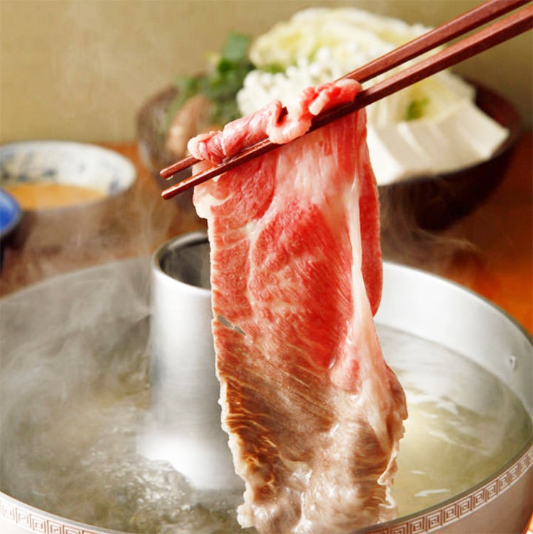 Cooked shabu shabu meat at one of the best restaurants in Tokyo called Aobaya