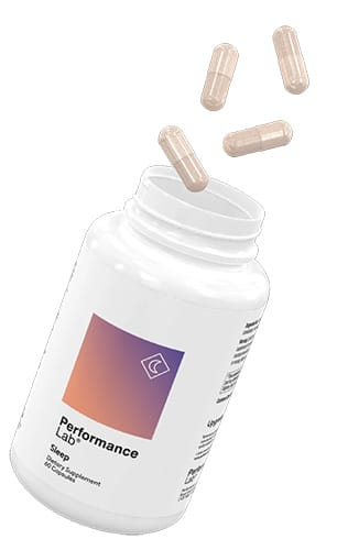 A bottle of Performance Lab Sleep with pills flying in the air